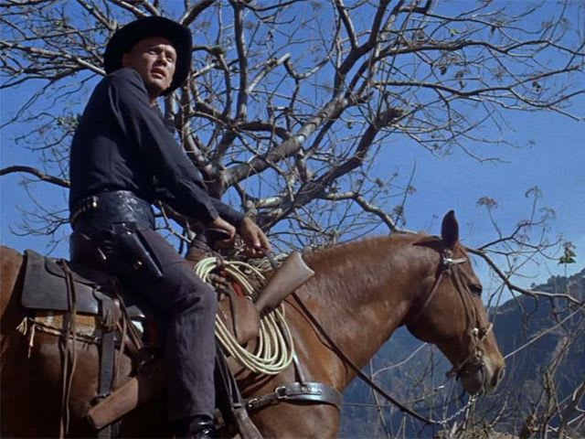 Which gunfighter believes going back will lead to their deaths, and so rides off alone?