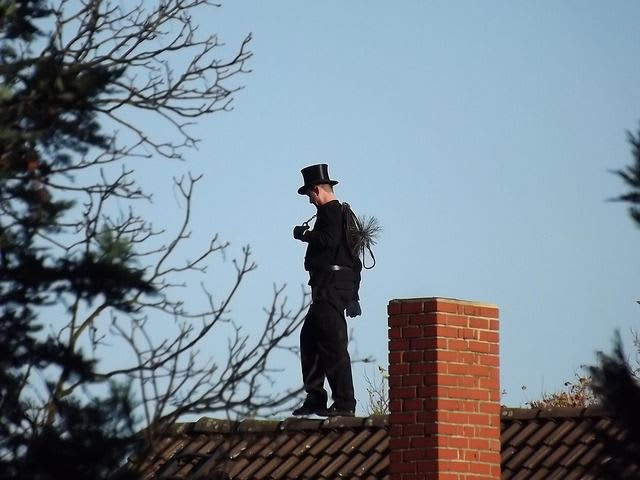 This is a chimney sweep. They clean chimneys with a big brush!