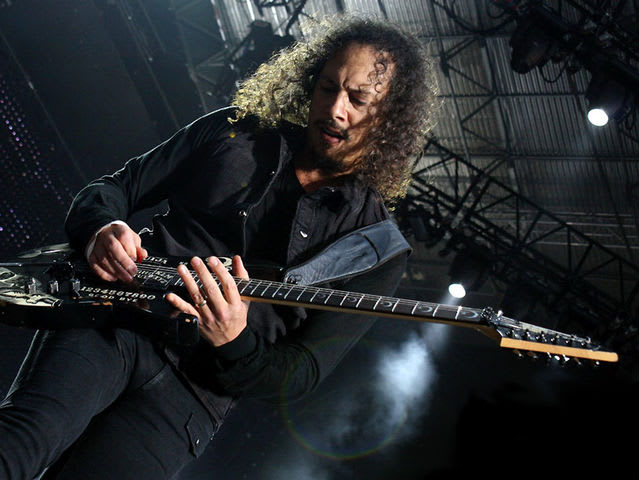 Kirk Hammett was taught to play guitar by which famous musician?