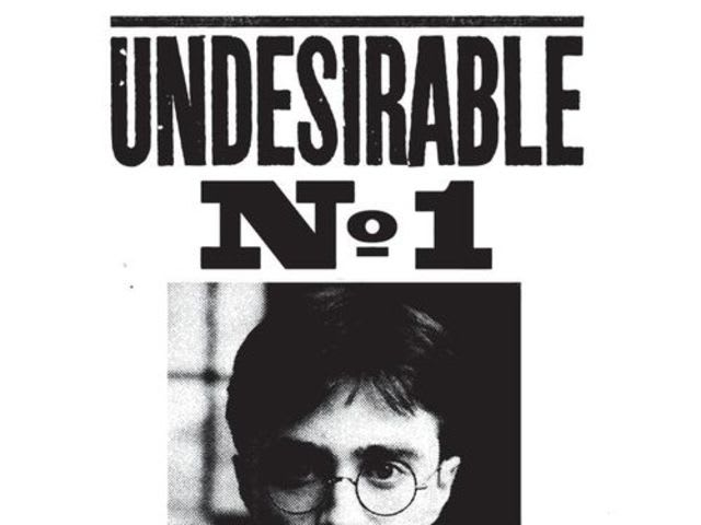 "In the films, who signed the ""Undesirable Number 1"" posters?"