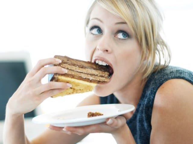 """A woman eats a piece of cake which causes her to experience an orgasm"""