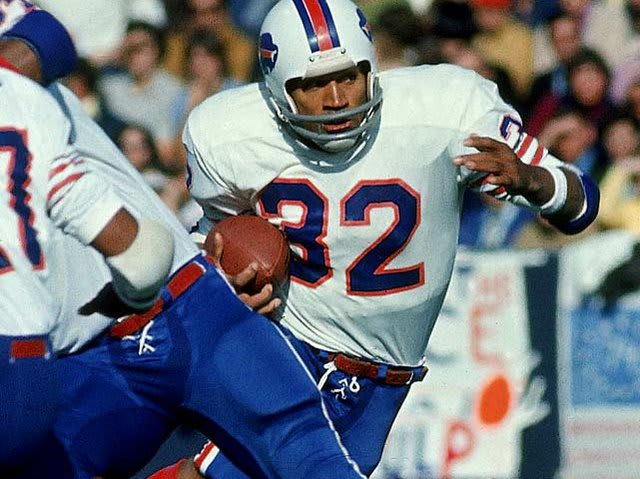 O.J. Simpson became the first NFL running back to run for how many yards in a single season in 1973?