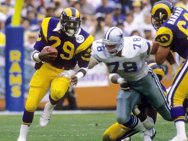 Currently, former Los Angeles Rams player Eric Dickerson holds the record at 2,105 yards ran in 1984