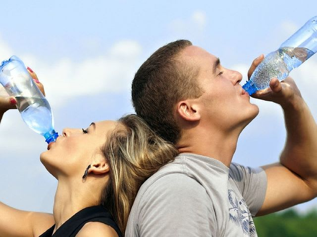 How should you drink your daily water intake?