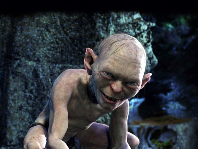 "In The Hobbit, Gollum asks:  ""Voiceless it cries, Wingless flutters, Toothless bites, Mouthless mutters.""  What is it?"