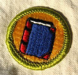 This boy scout badge was available until 1987. They apparently knew that print media was on its way out even then.