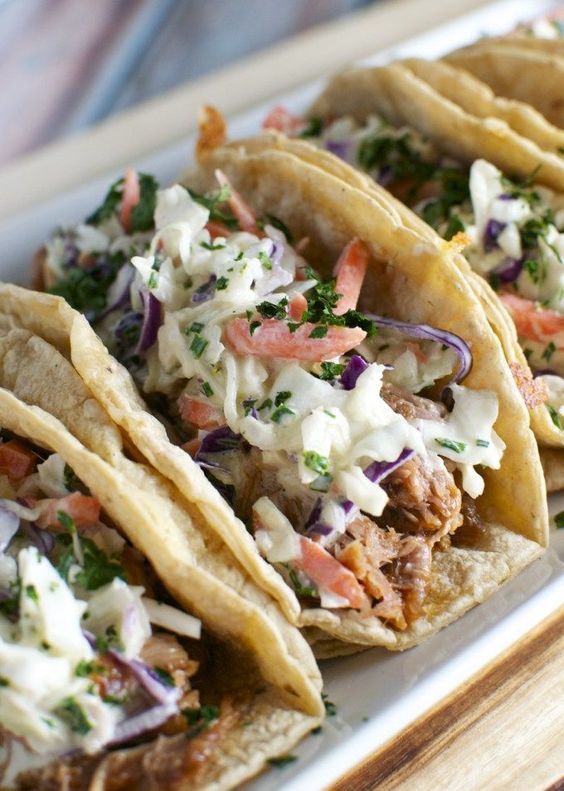 Barbecue Pork Tacos are made in the slow cooker and topped with a honey mustard slaw.