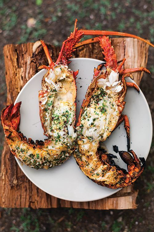 Lobster is flash-grilled, then poached in its own shell in a pool of melted garlic-parsley butter.