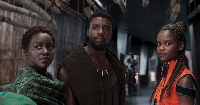 T'Challa flanked by the only two reasons he's still alive at this point in his life, Wright's beyond-delightful Shuri being furthest right.