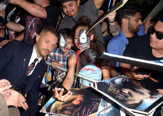 Hardy poses with Venom fans at the premiere, courtesy of Getty Images.