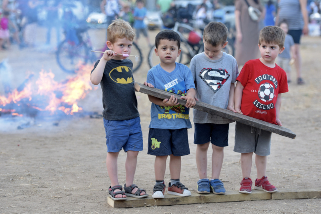 Children enjoy eating roasted marshmallows and collecting wood for the bonfire. (Credit: Avshalom Sassoni / Maariv)