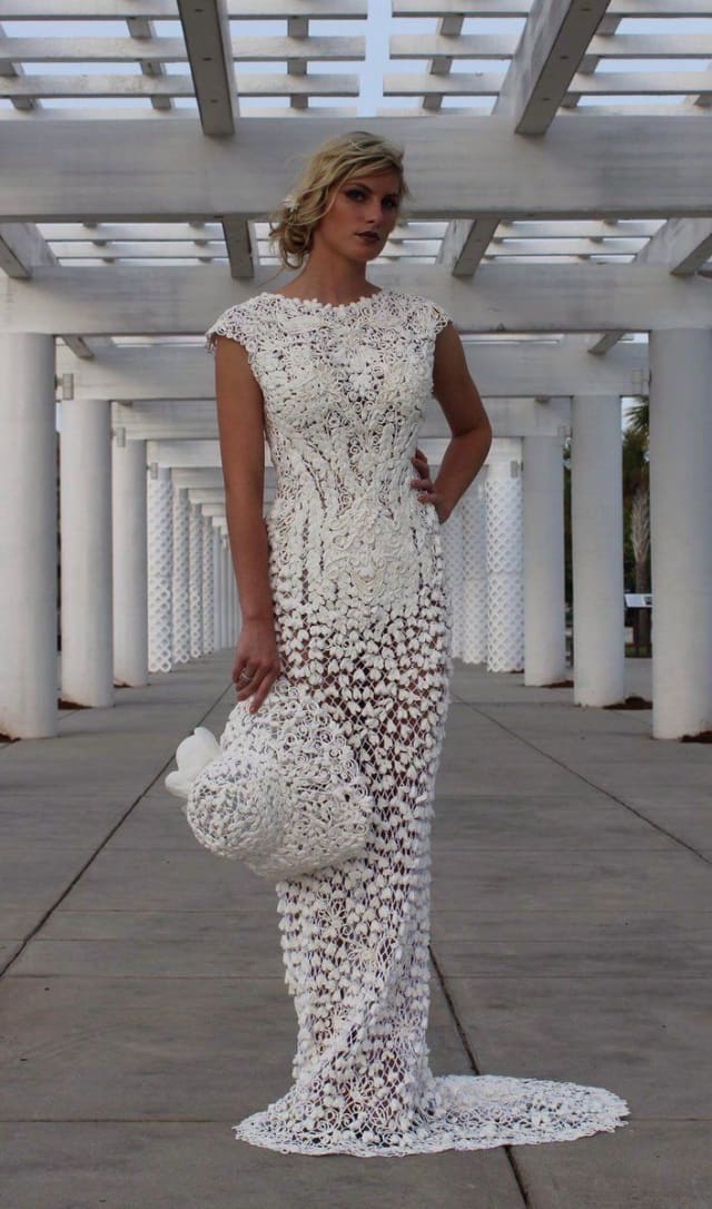 This sheer gown by Mimoza Haska nets hundreds of toilet paper flowers to create a floral dress worth drooling over (just not literally, because, you know, the toilet paper won't hold up.) The matching hat goes the extra mile to give this sheath added retro flair.