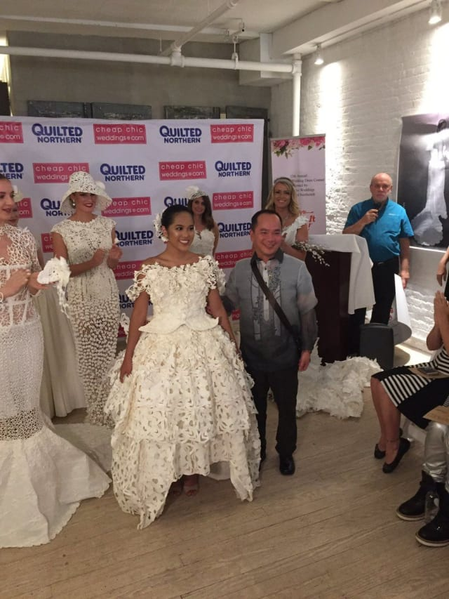 Roy Cruz submitted this unique tea-length high-low gown that combines modern design with traditional Latin-American flare using dozens of layers of toilet paper.