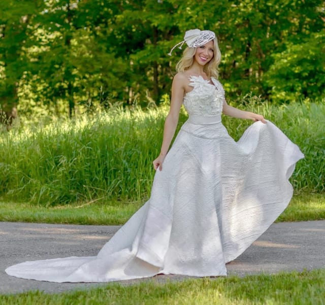 Susan Brennan submitted this stunning toilet paper gown, with a surprisingly sturdy and thick quilted skirt. The added texture brings a beautiful richness to gown that is matched only by its floral neckline and matching birdcage veil.