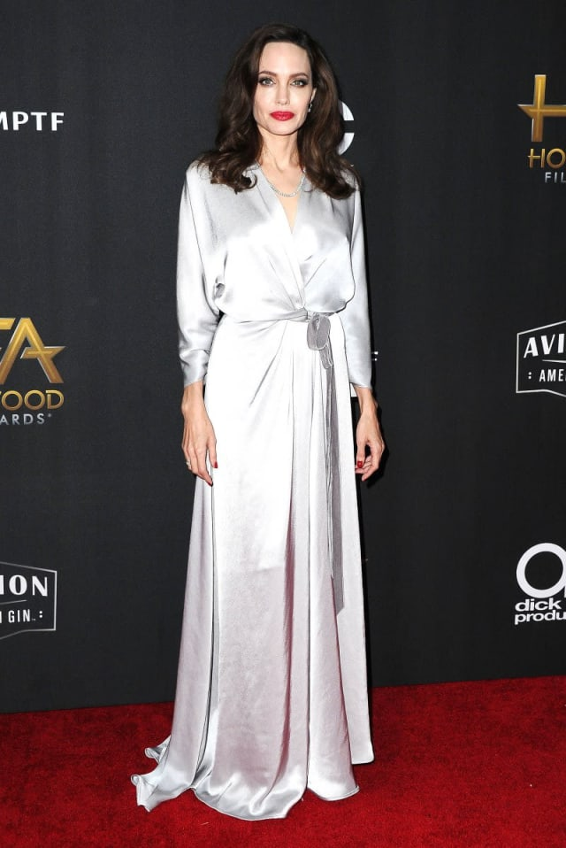 Angelina Jolie looking flawless in a sophisticated, silver gown