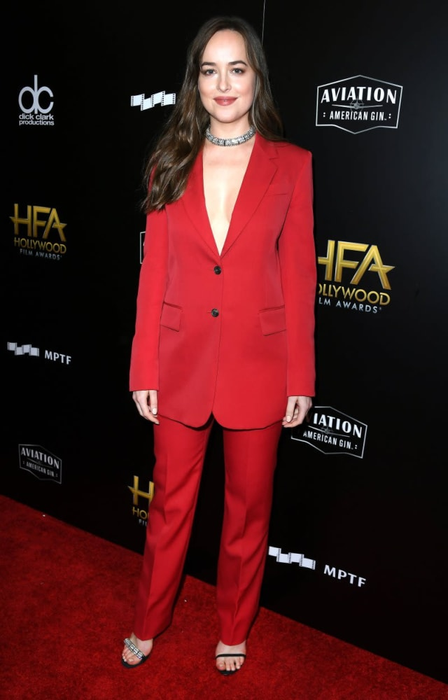 Dakota looking incredibly cool in this plunging neckline red suit.