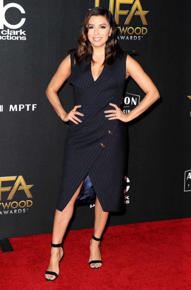 Eva Longoria pulling out all the stops in a pinstripe wrap-around dress.