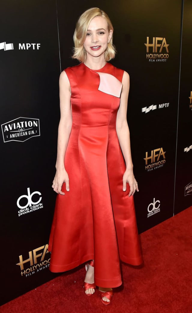 Carey Mulligan looking sultry in a red gown with matching heels.