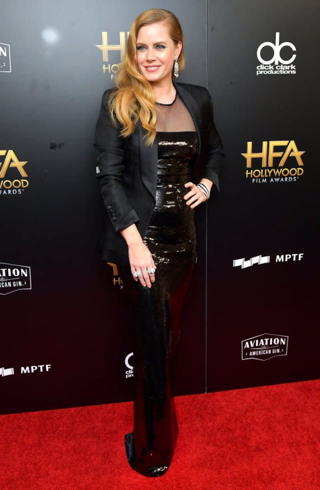 Amy Adams rules the red carpet in a black sequin gown underneath a chic black blazer.