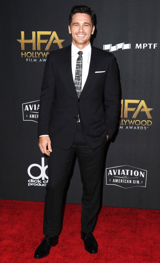 James Franco looking dashing in a black suit and patterned tie.