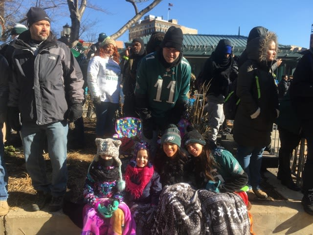 Jason Burns with his four daughters join crowd, from left, Samantha, 6; Abby, 5; Taylor, 21, and Madison, 15.