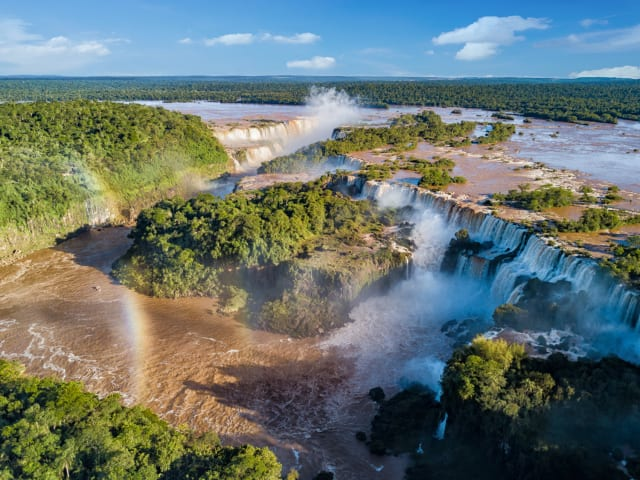 Holy Moly! Count me in on this one. This is Iguazu falls. Maybe we can start by going to Argentina? By the way, did you know this is also home to another legend? Say hello to, Lionel Messi! If you just googled who he was, I am so disappointed in you right now...