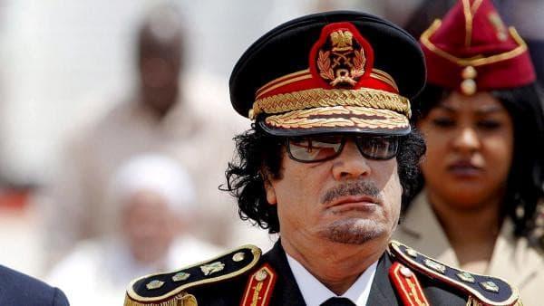 Muamar Muhamad Abu-minyar el Gadafi, Hermano líder y guía de la Revolución de Libia.-