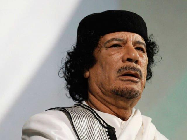 Muamar el Gadafi.-