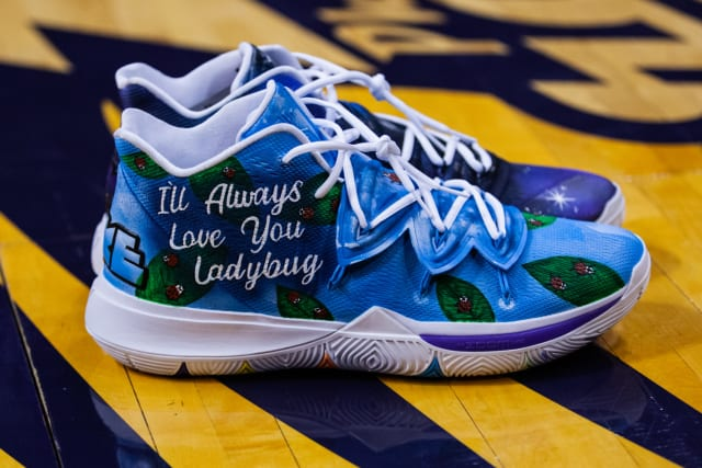"The starting point of Brittney Griner's mismatched pair was her mom and the two encouraging phrases she often heard growing up. Griner was dubbed ""Ladybug"" by her mother years ago, and the right shoe features a sky blue base and ladybugs crawling on leaves throughout the upper. The opposite shoe pulls from her mom's saying, ""I love you to the moon and back,"" with the quote, a moon crater and a starry space graphic making up the left shoe."